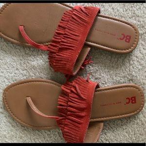 Orange fringe thong sandal